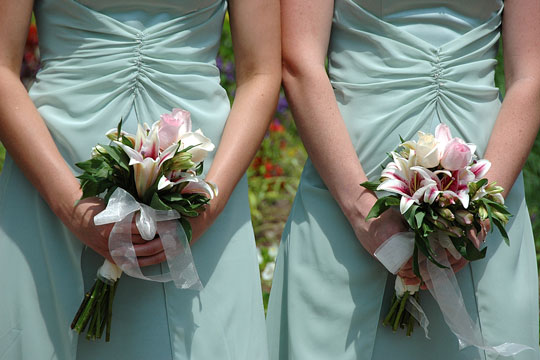 two bridesmaids with flowers